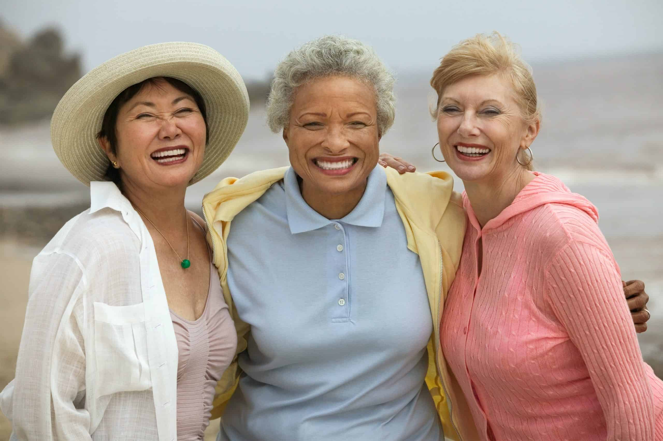 three smiling women of different ethnicity Being OK With their Differences