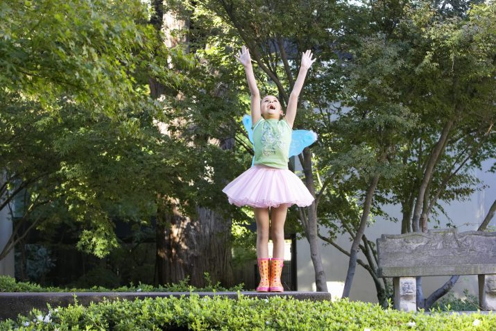 little girl wearing a tutu and fairy wings