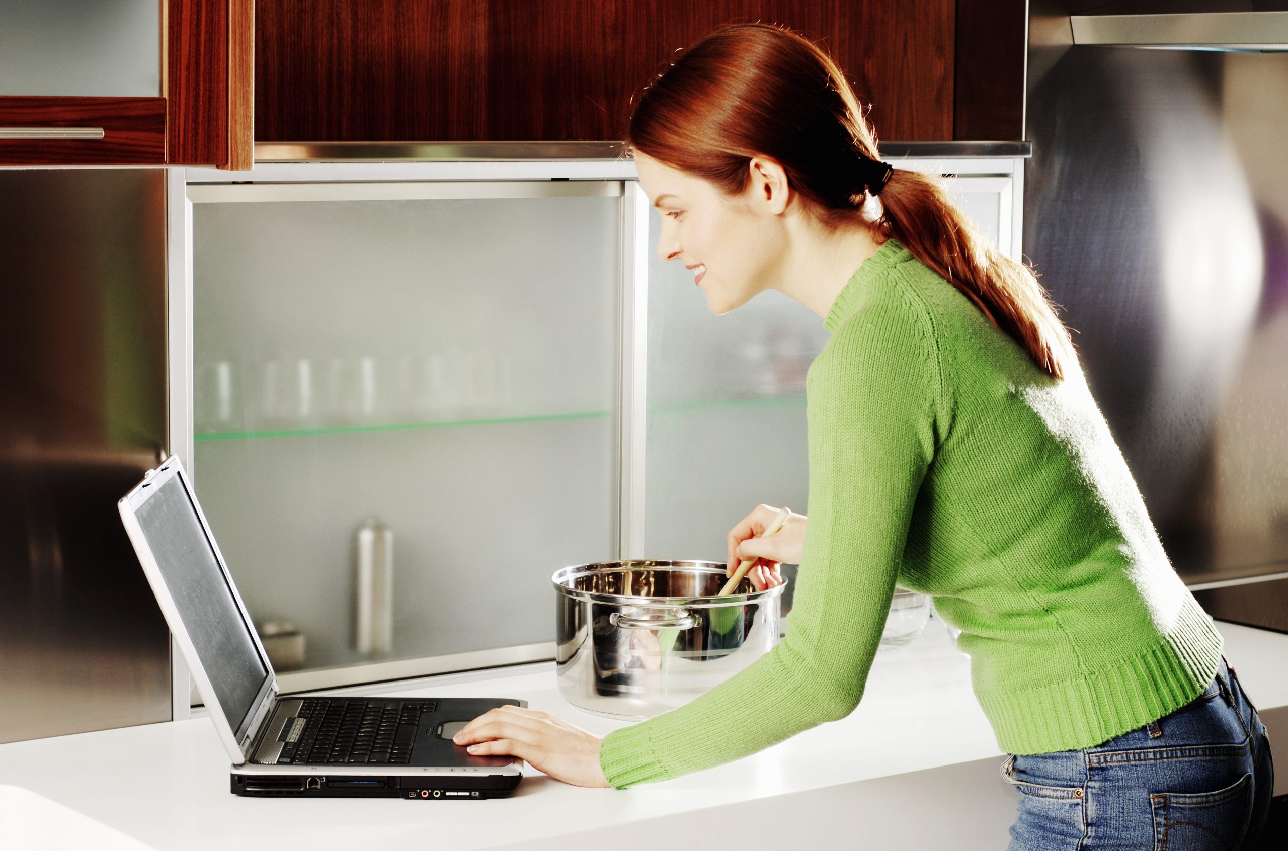 woman working while cooking