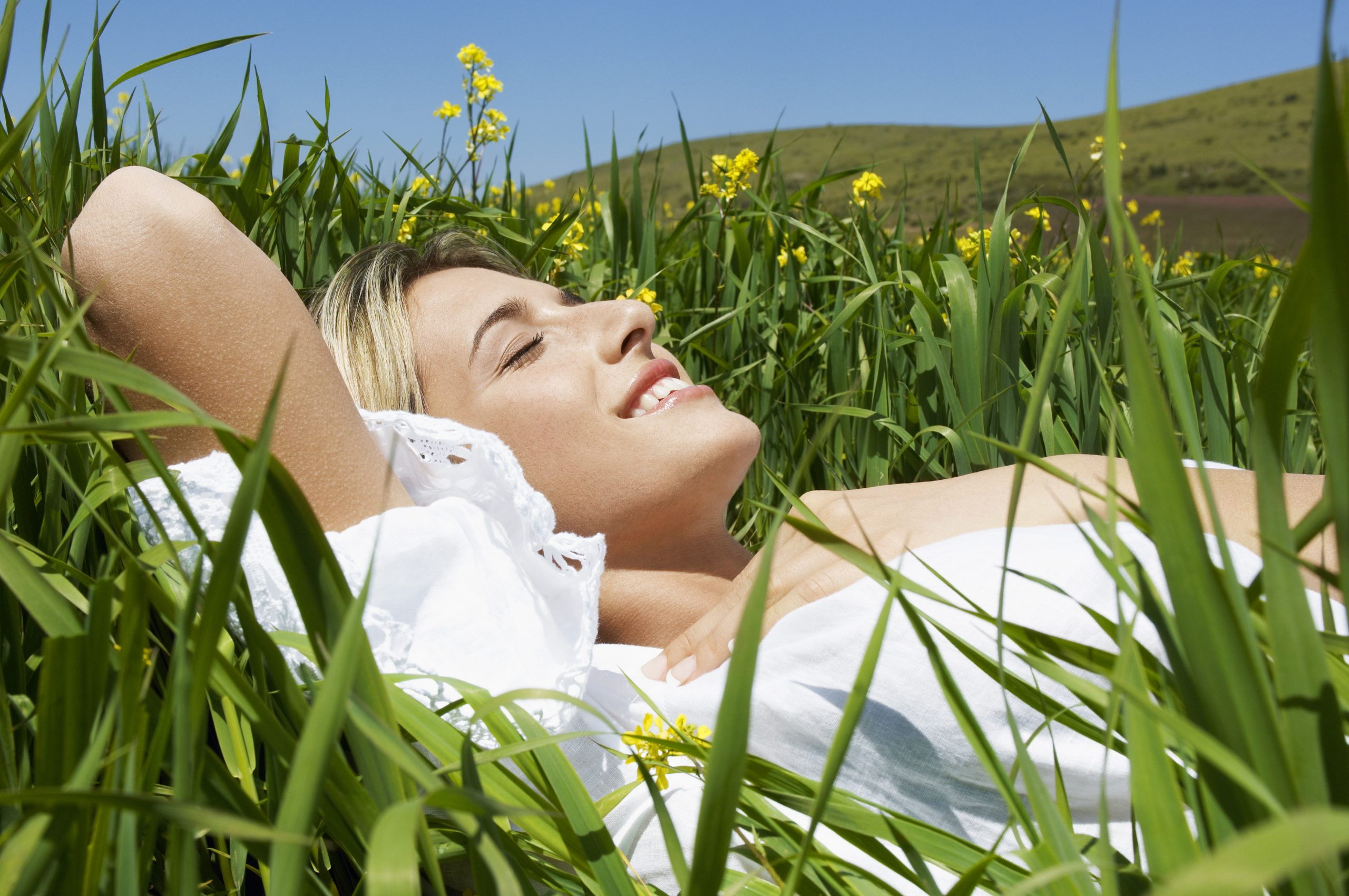 contented woman in a field