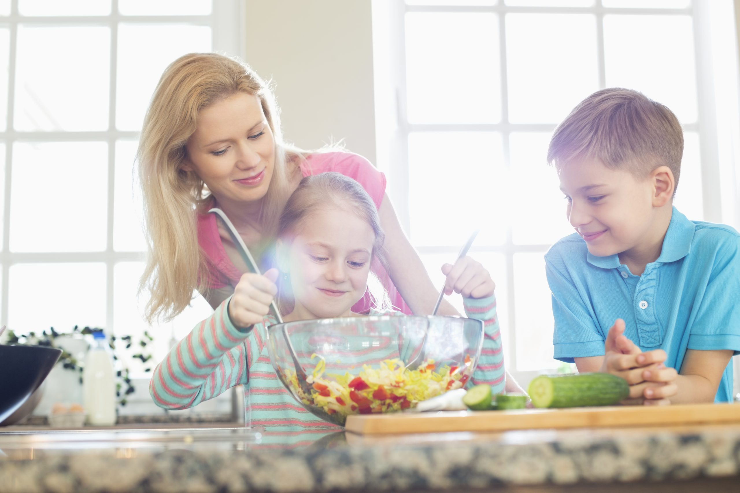 mom spending time with kids cooking